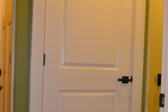 2-panel square top door with 1x4 casing and 280 backband attached